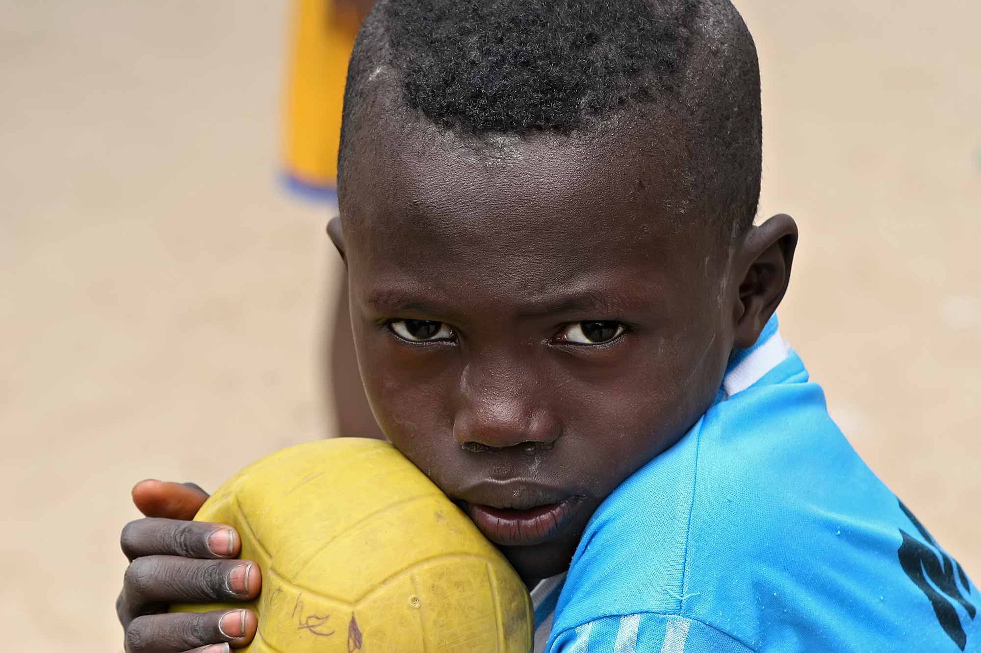 boy-with-soccer-ball-dakar-senegal-africa