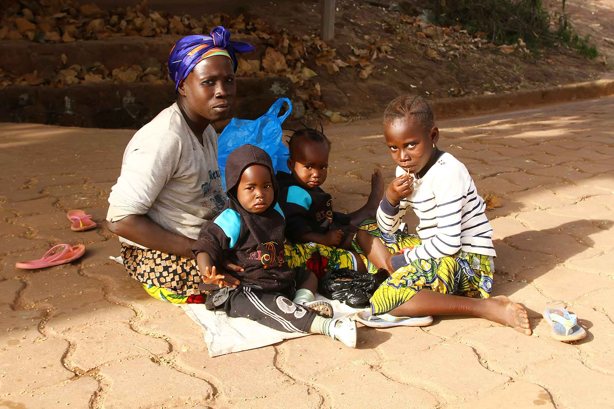 family-sitting-in-streets-of-bobodioulasso-burkina-faso