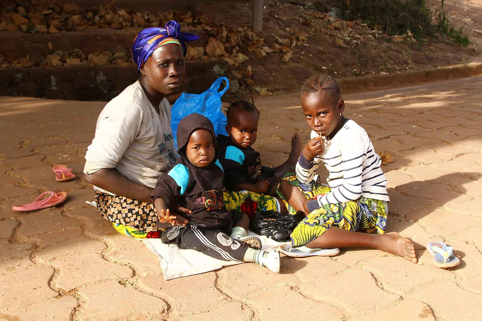 family-sitting-in-streets-of-bobodioulasso-burkina-faso