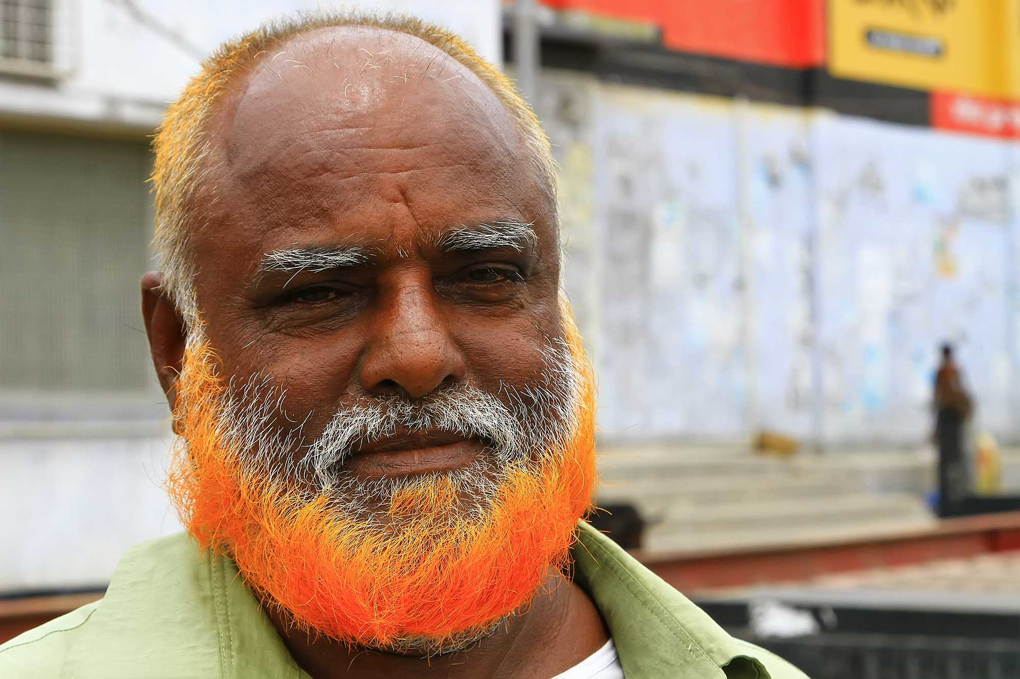 man-orange-beard-khulna-port-bangladesh