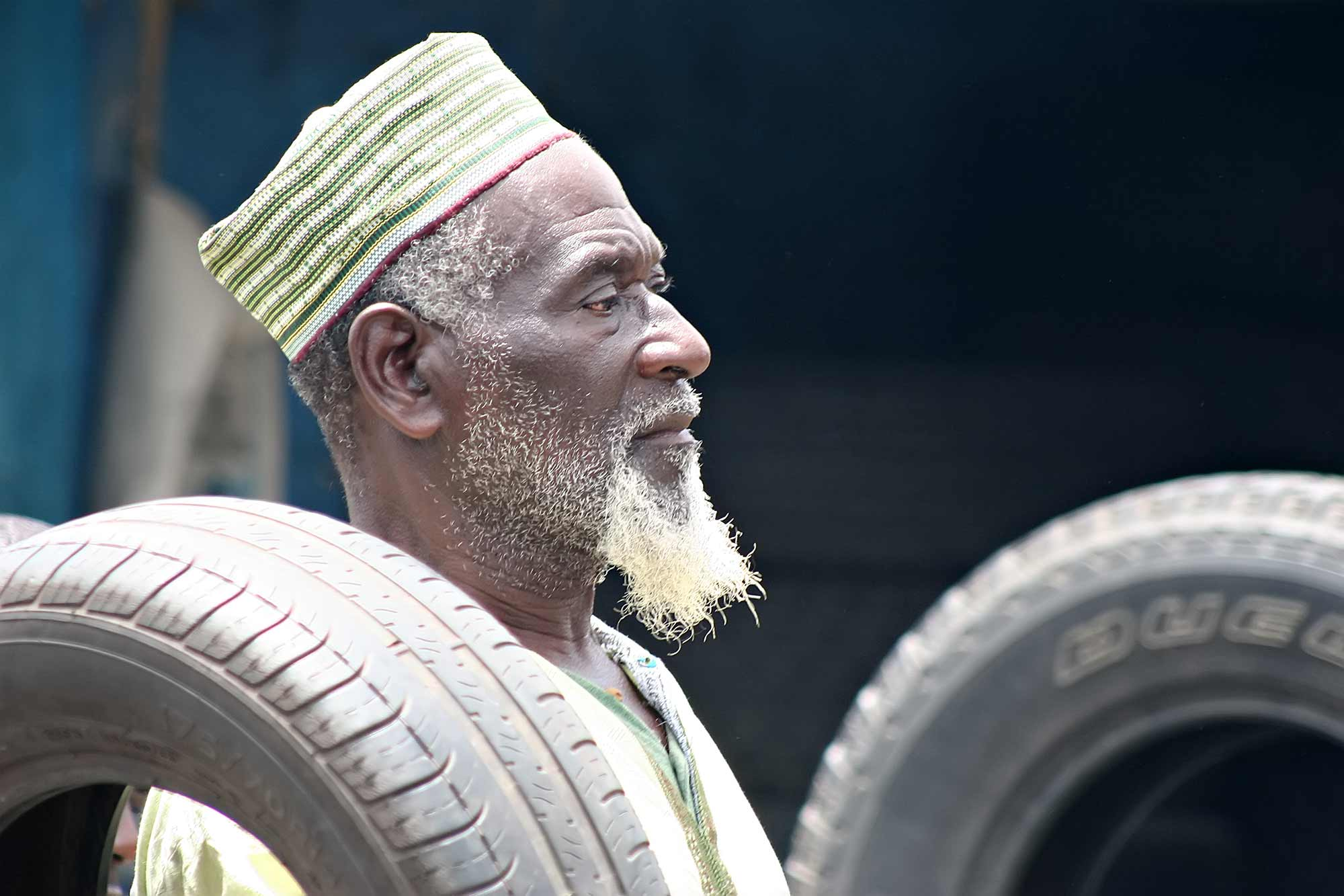 man-with-tires-accra-ghana