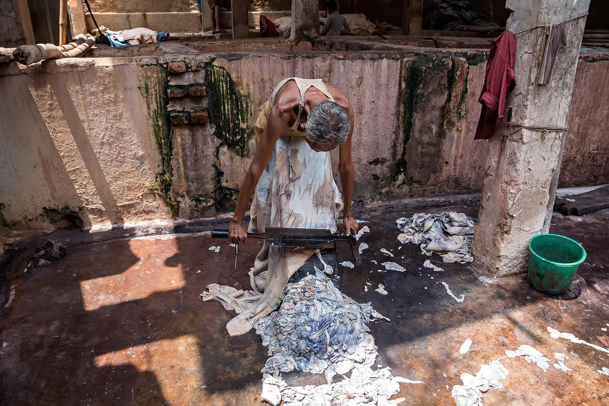 Man working in a leather tannery in Dhaka, Bangladesh. © Ulli Maier & Nisa Maier