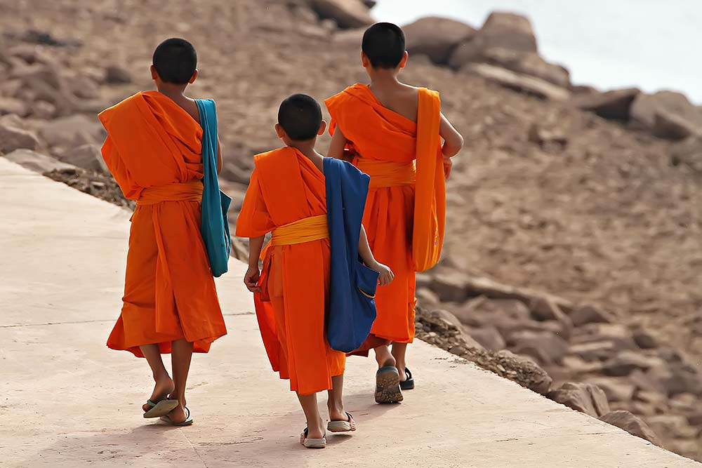 monks-walking-along-the-mekong-vientiane-laos-featured
