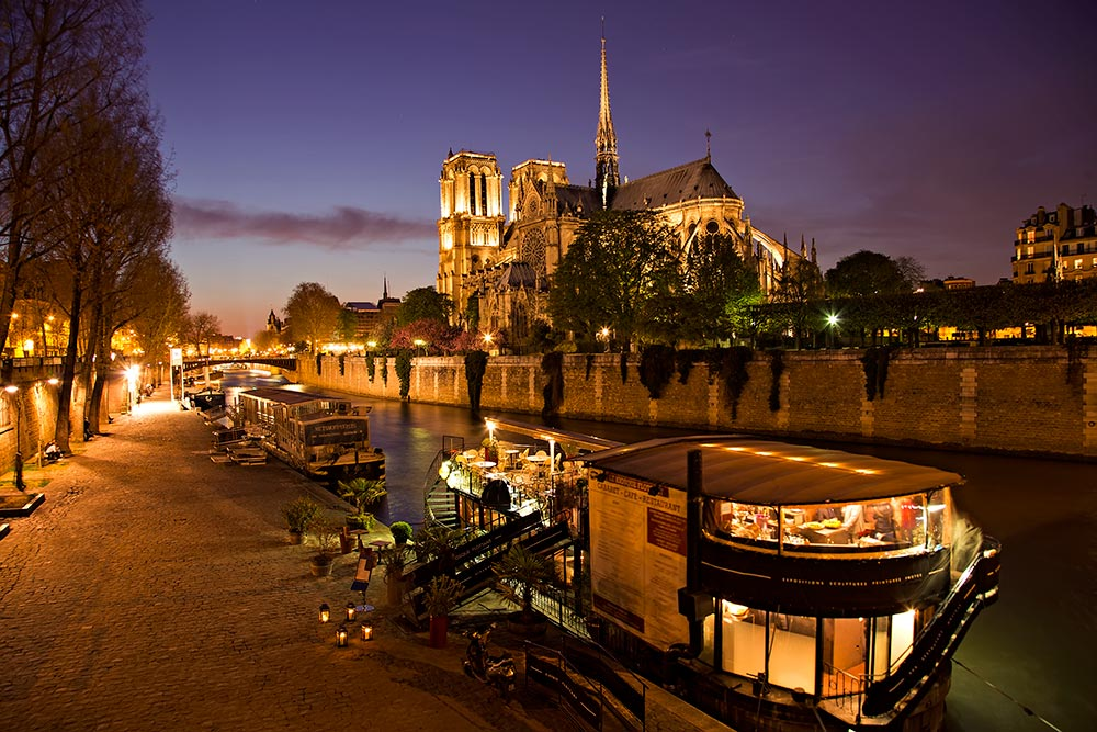 notre-dame-cathedral-night-seine-paris-france-featured