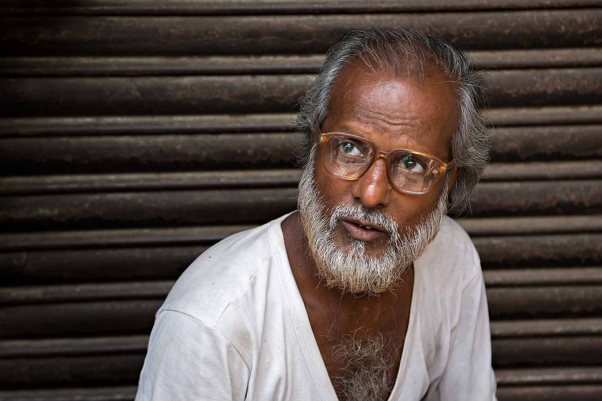 portrait-man-with-glasses-streets-kolkata-west-bengal-india