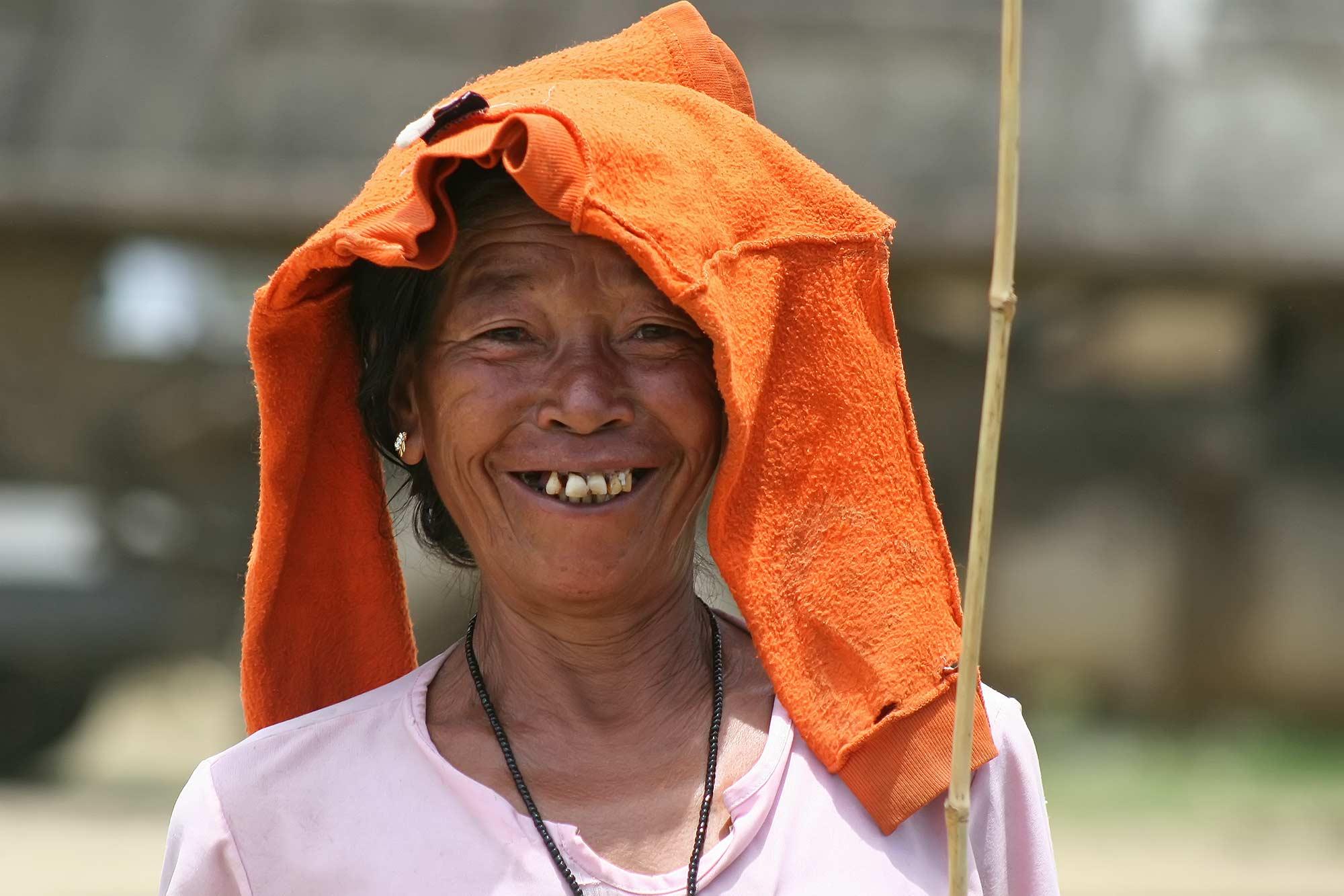 portrait-smiling-woman-lake-logtak-manipur-india