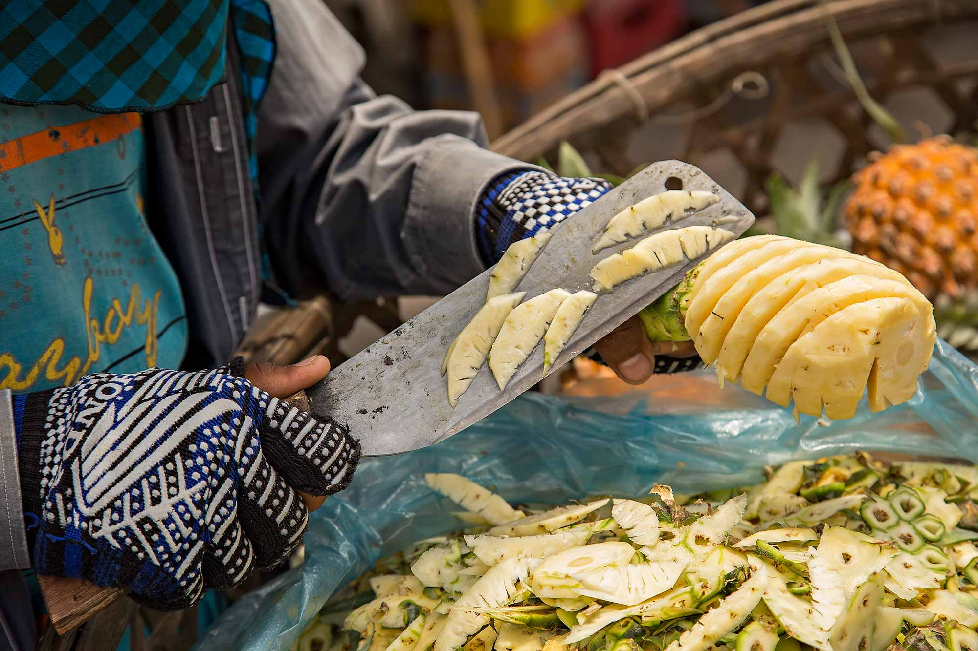 Cutting fresh pineapple at the Russian market in Phnom Penh, Cambodia. © Ulli Maier & Nisa Maier