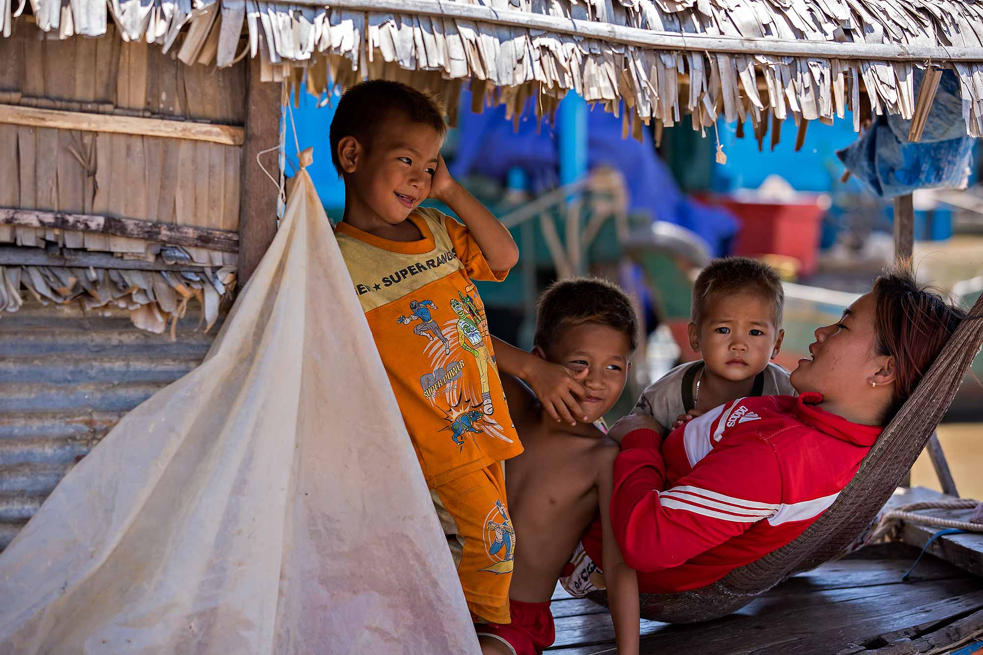 A family living in a floating village at Tonle Sap lake, Cambodia. © Ulli Maier & Nisa Maier