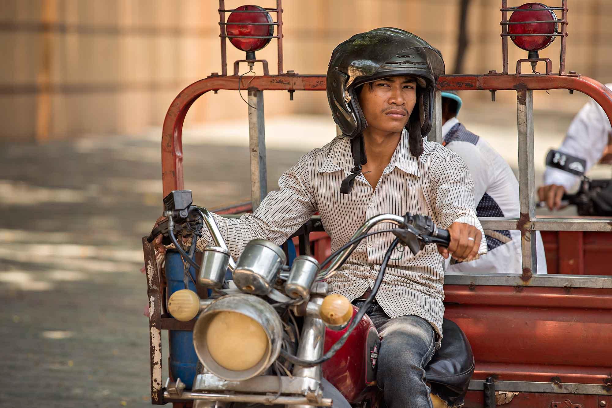 Man on a motorbike in Phnom Penh, Cambodia. © Ulli Maier & Nisa Maier