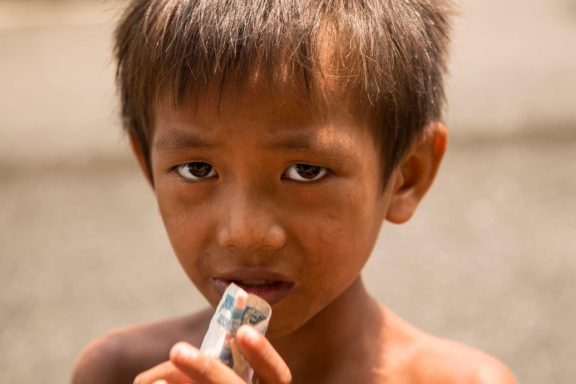 Portrait of a street boy in Phnom Penh, Cambodia. © Ulli Maier & Nisa Maier