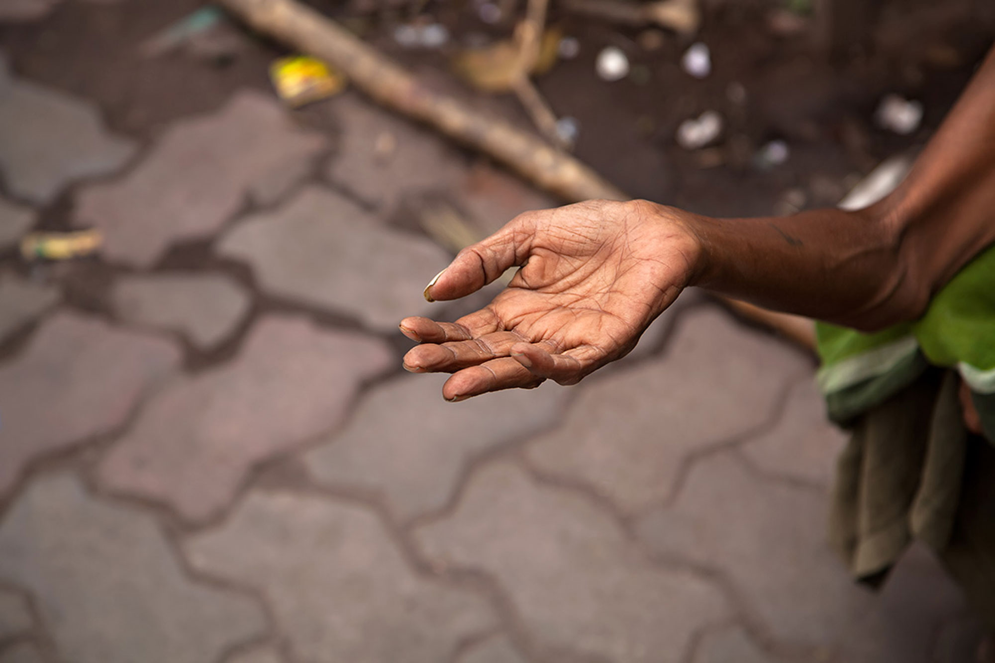 Hand of a begging woman in the streets of Kolkata, India. © Ulli Maier & Nisa Maier