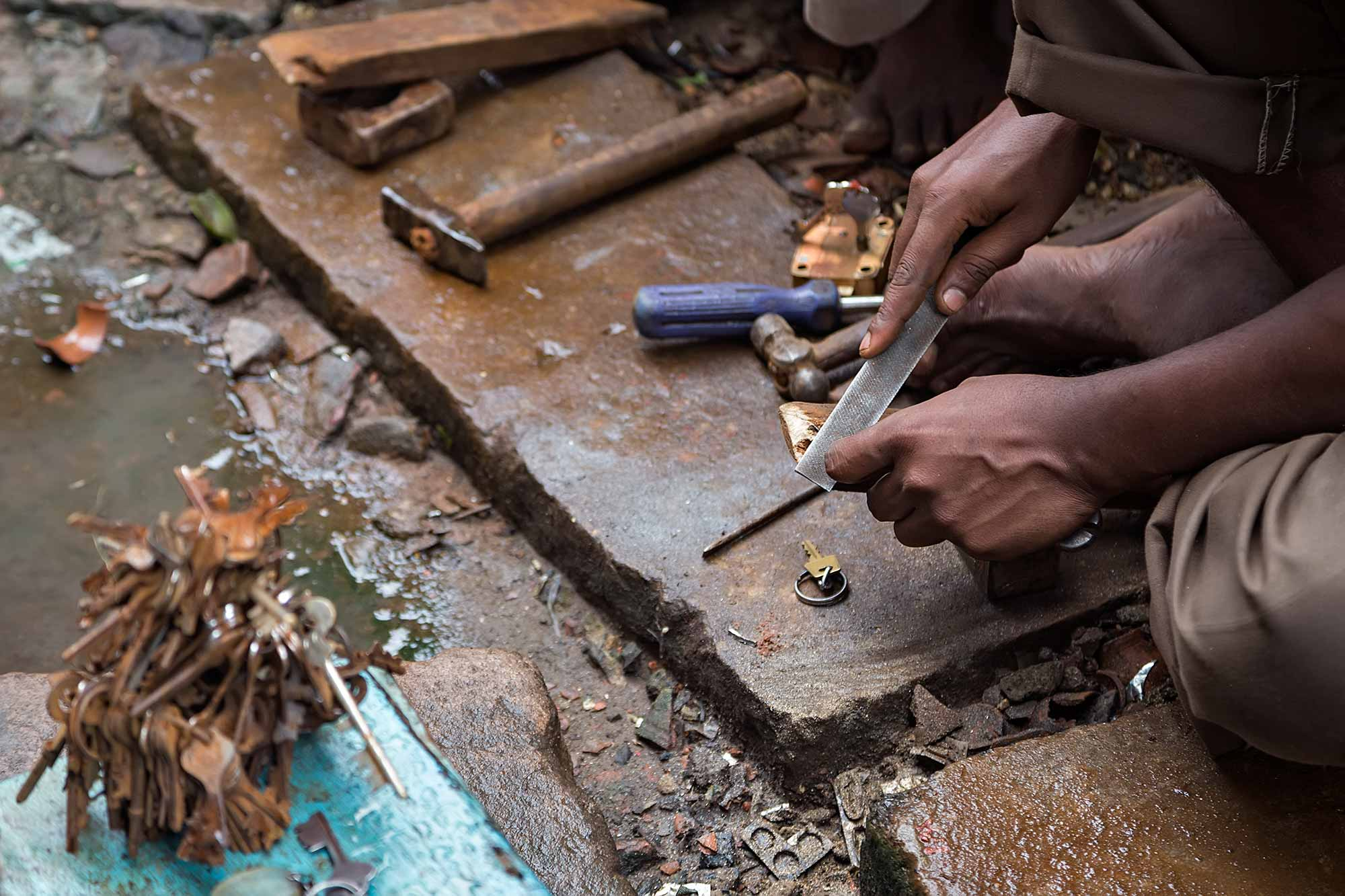 Hands of a key maker in the streets of Kolkata, India. © Ulli Maier & Nisa Maier
