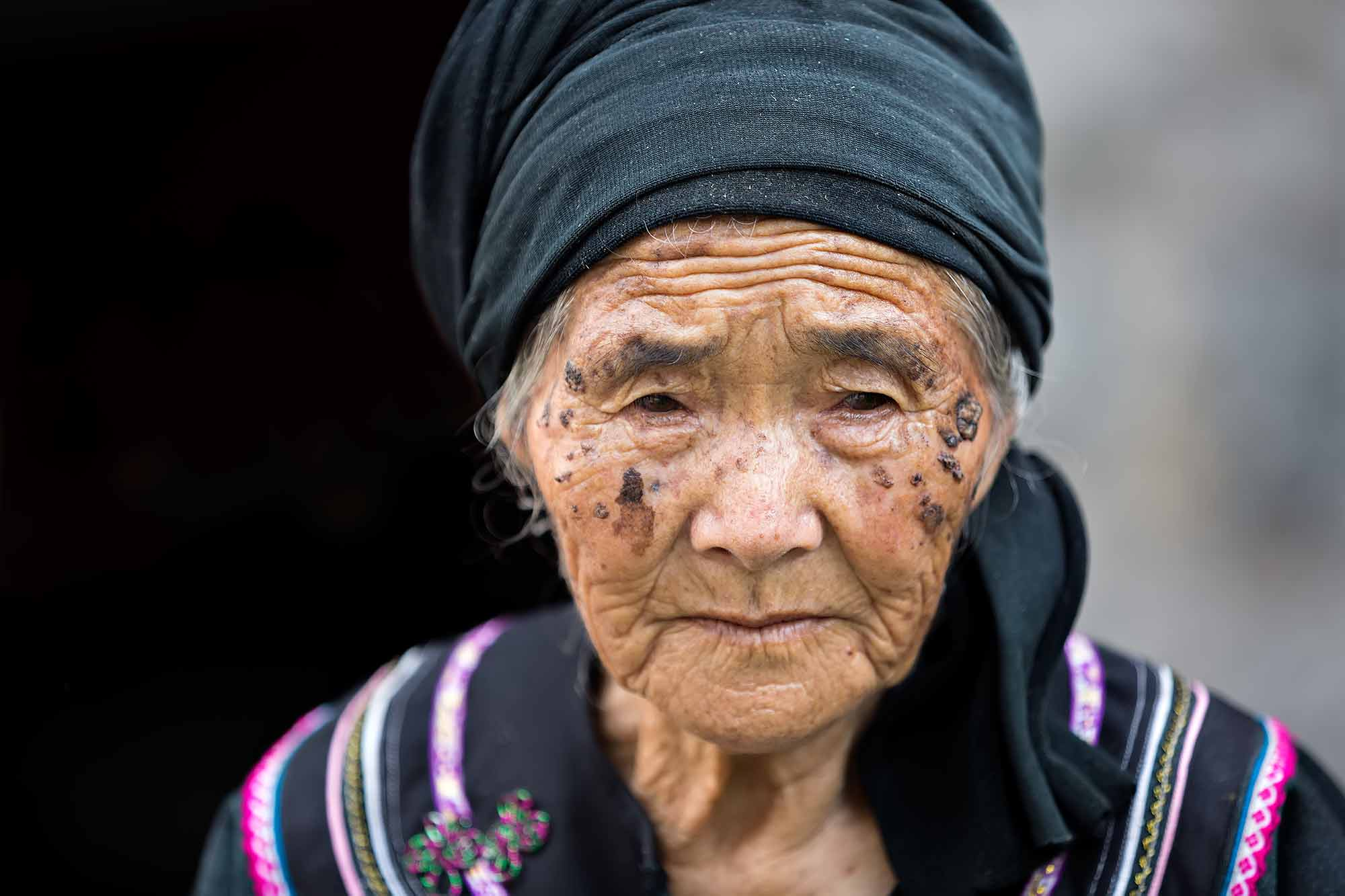 Portrait of a tribal woman in Duoyishu, Yunnan. © Ulli Maier & Nisa Maier