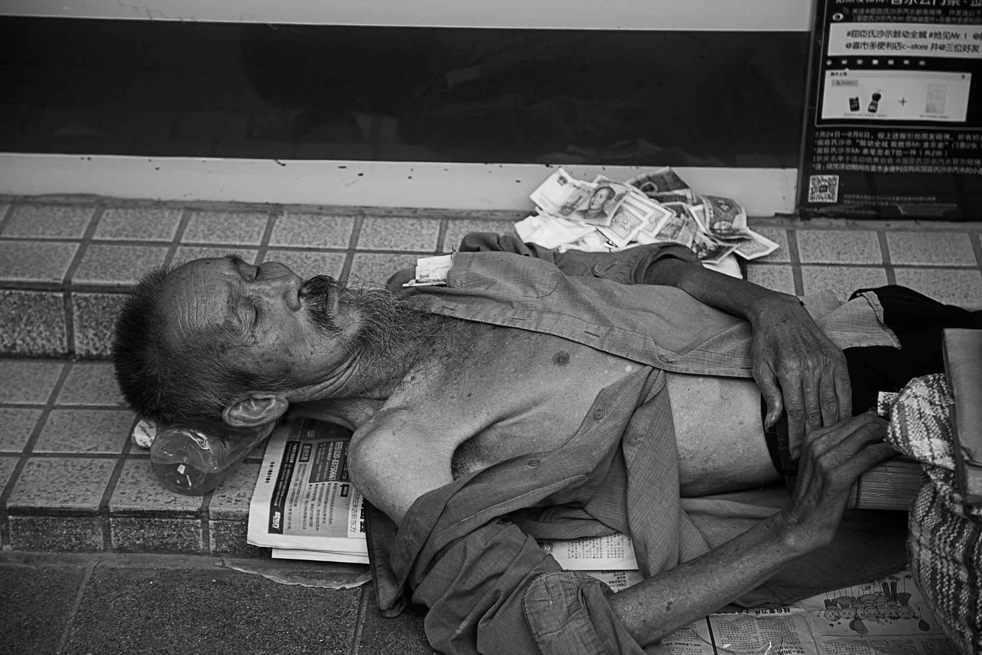 homeless-man-streets-guangzhou-china