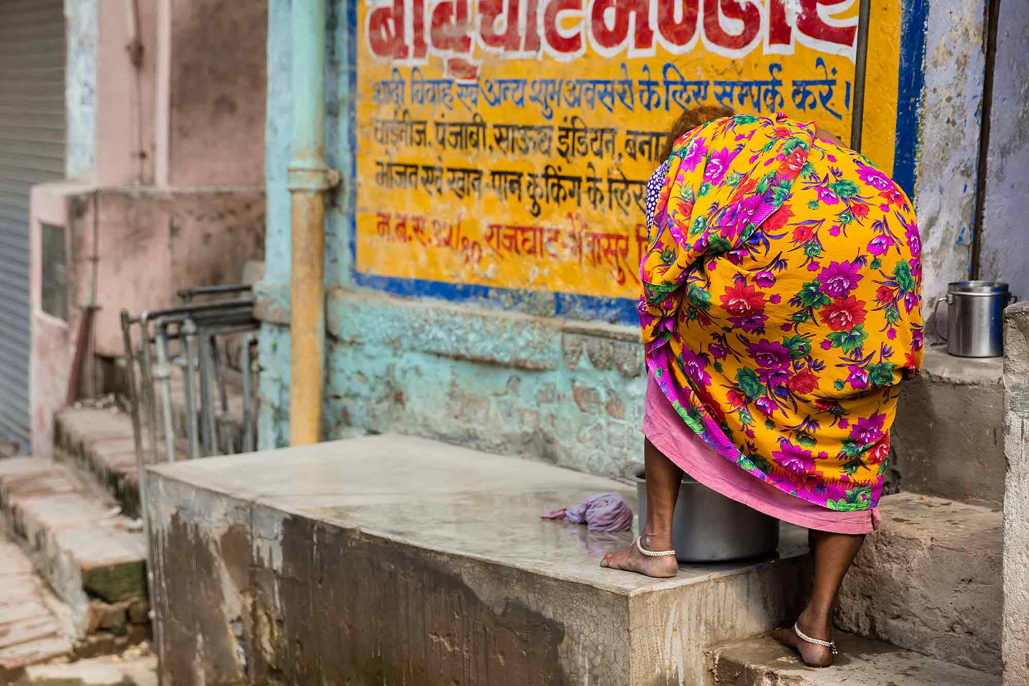 woman-washing-cloths-streets-varanasi-india