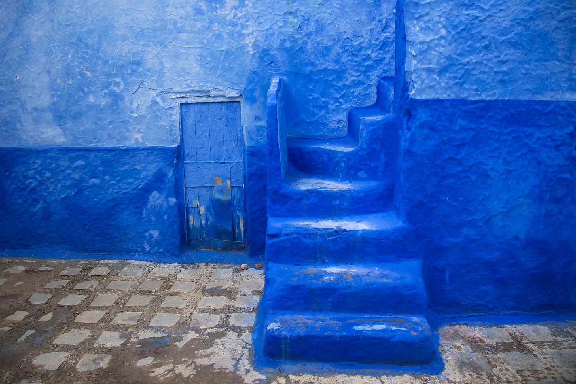 Bright-blue buildings and narrow lanes cover Chefchaouen. © ULLI MAIER & NISA MAIER