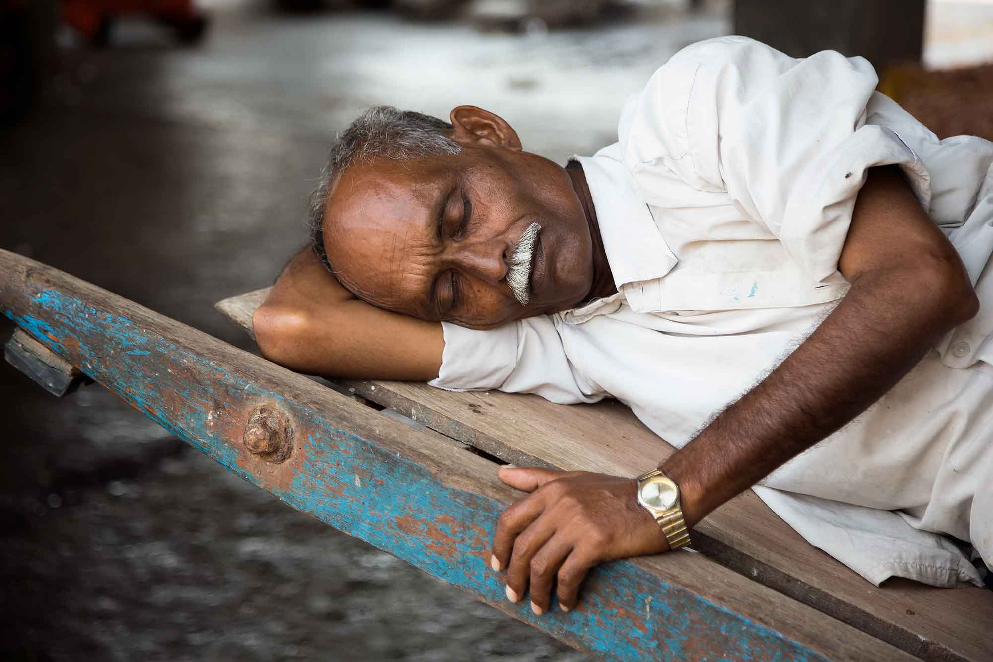 sleeping-man-train-station-mumbai-india