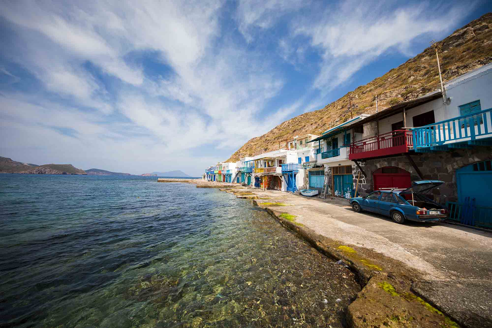 The colourful fishing village of Klima can be seen from the ferry when arriving on Milos island. © ULLI MAIER & NISA MAIER