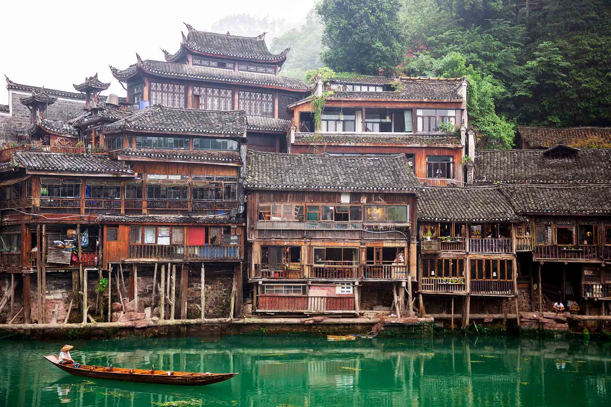 Fenghuang Ancient Town, is situated on the western boundary of Hunan Province in an area of outstanding natural beauty where mountains, water and blue skies prevail. 'Fenghuang' is Chinese for 'Phoenix', the mythical bird of good omen and longevity that is consumed by fire to be re-born again from the flames. Phoenix Ancient Town is so called as legend has it that two of these fabulous birds flew over it and found the Fenghuang Town so beautiful that they hovered there, reluctant to leave. © ULLI MAIER & NISA MAIER